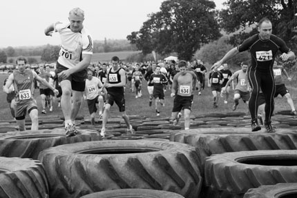Running over the tyre obstacle
